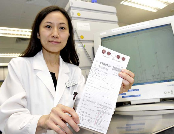 Dr. Liz Yuet Ping YUEN, Consultant, Department of Chemical Pathology, CUHK, showsthe sample filter paper for IEM screening test.